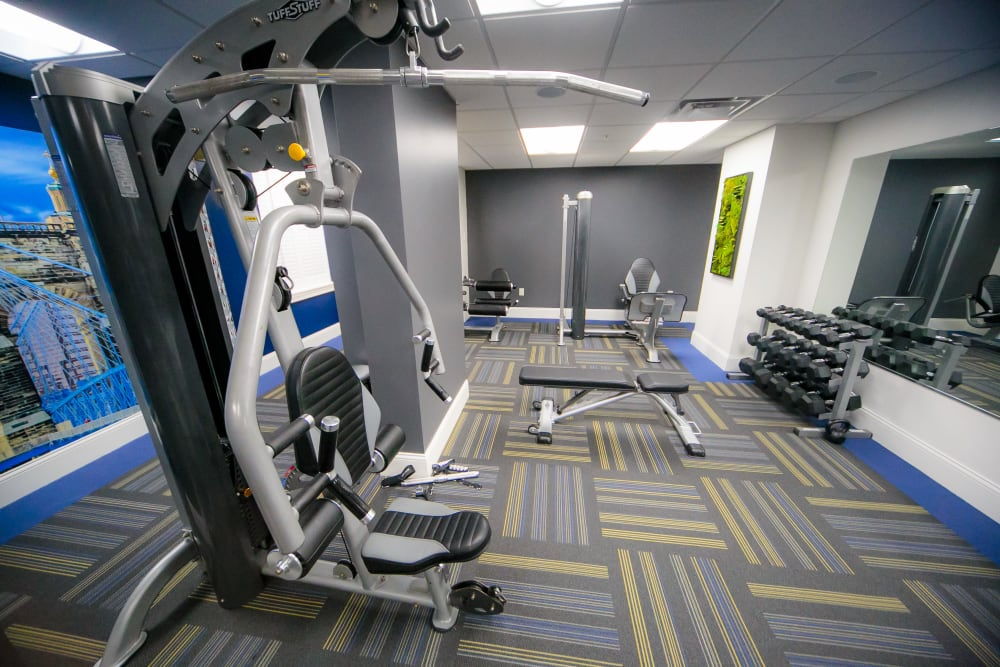 Fitness center featuring free weights and modern workout equipment at The Reserve at 4th and Race in Cincinnati, Ohio