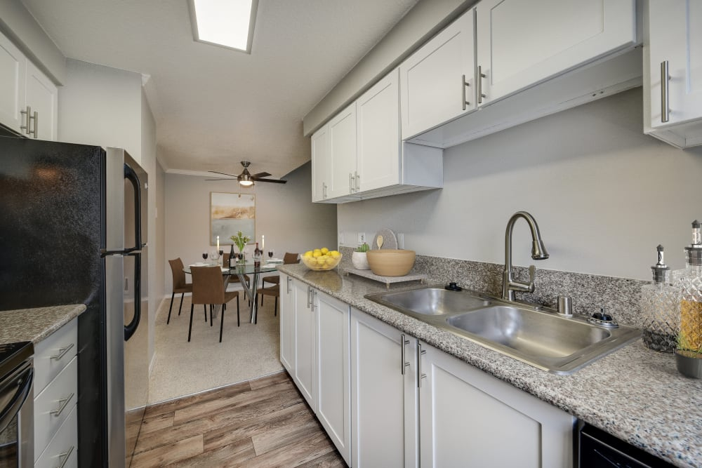 Kitchen with wood-style flooring at Walnut Grove Landing Apartments in Vancouver, Washington