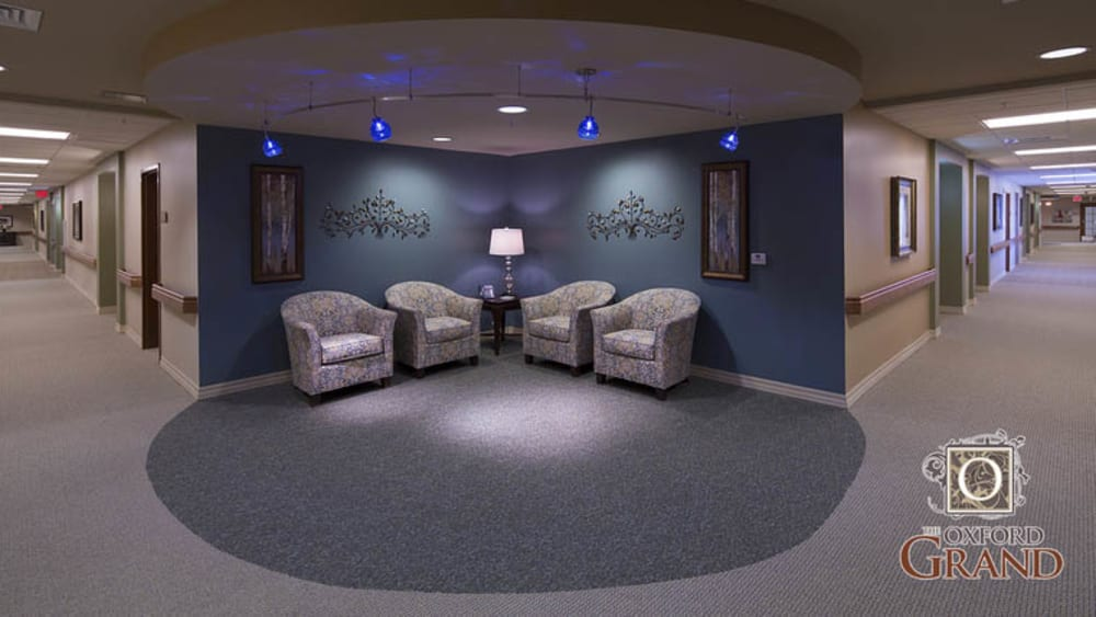 Sitting area with calm lighting at The Oxford Grand Assisted Living & Memory Care in Wichita, Kansas