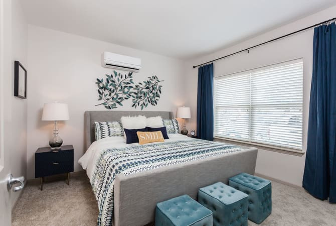 Spacious bedroom at Village Heights Senior Apartments in Fairport, New York