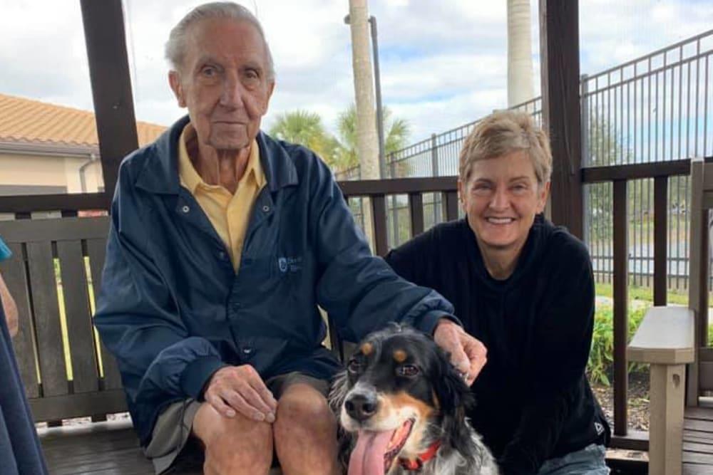 A resident and his dog at Inspired Living Bonita Springs in Bonita Springs, Florida