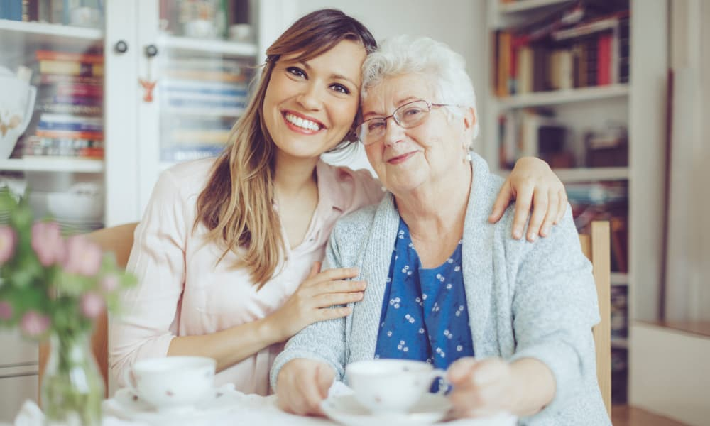 Senior lady and young lady enjoying coffee