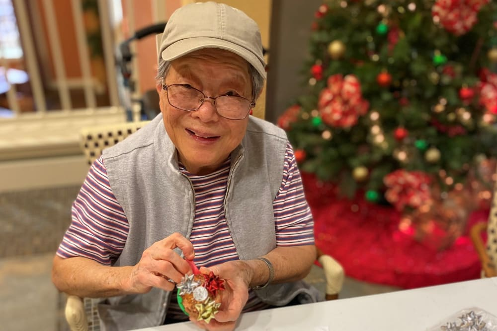 senior resident enjoying a holiday party at The Pines, A Merrill Gardens Community in Rocklin, California.