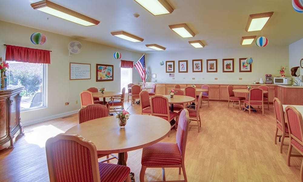 Activities room with round tables and spacious seating at Randall Residence of McHenry in McHenry, Illinois