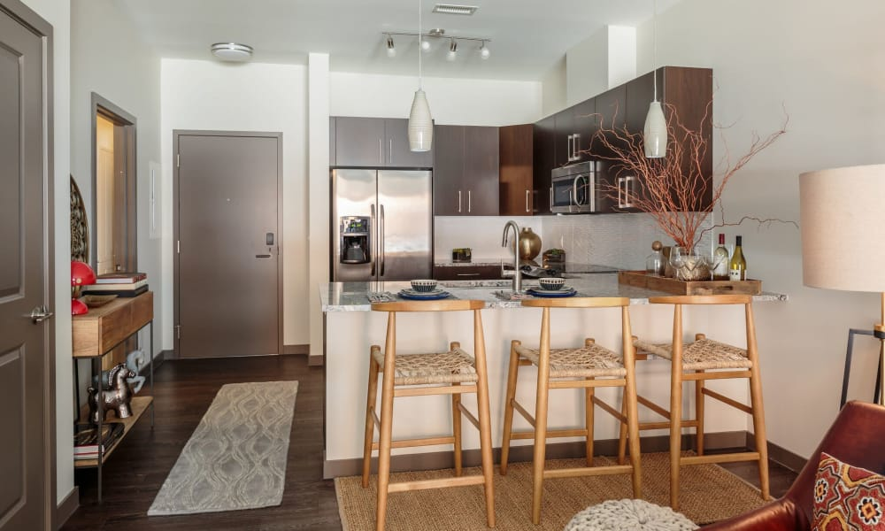 Kitchen with stainless steel appliances at Eastside Bond Apartments
