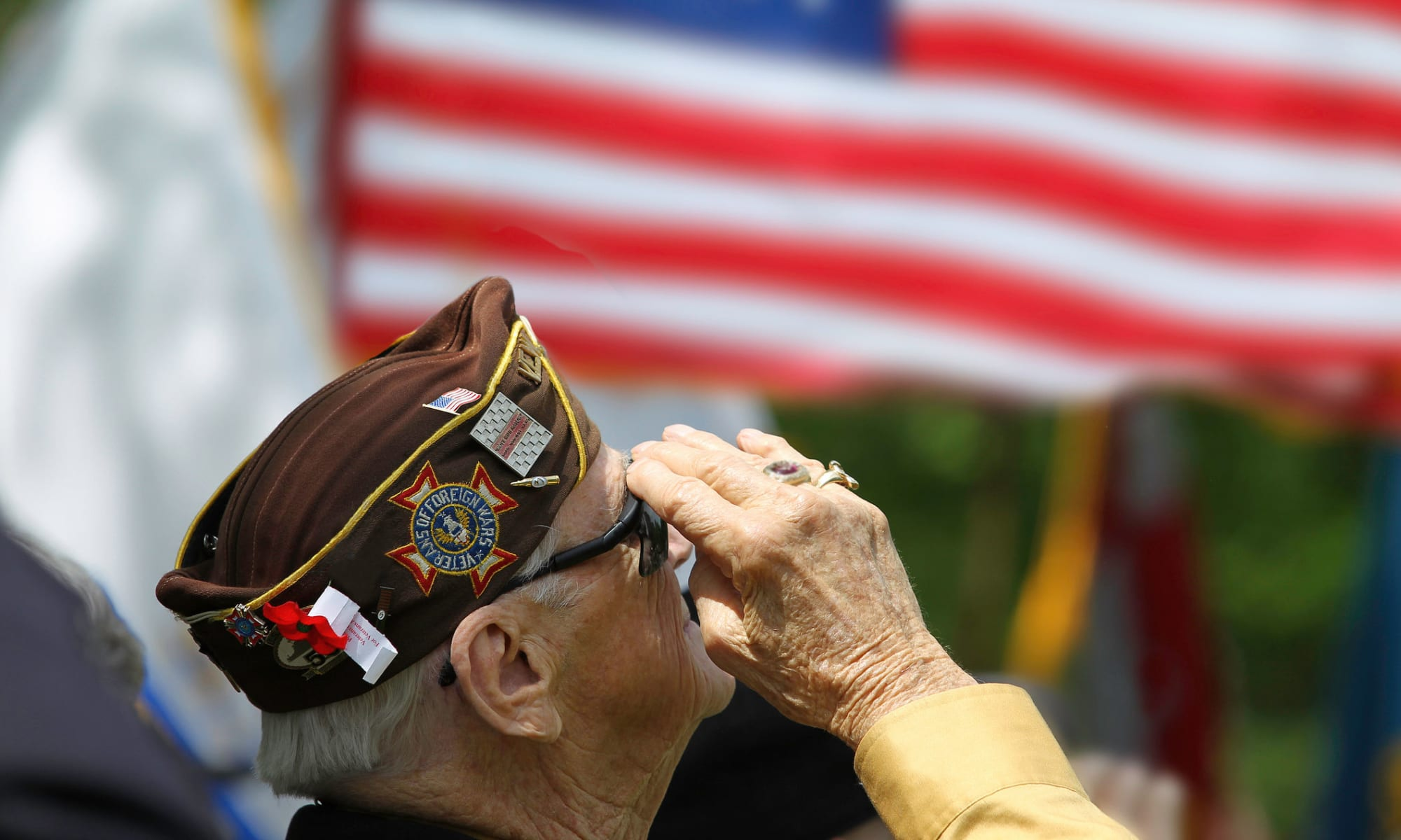 A veteran salutes the flag at Broadwell Senior Living in Plymouth, Minnesota