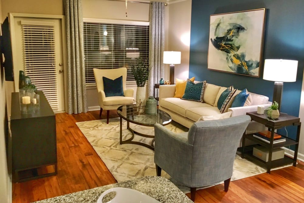 Well-furnished living space in an open-concept model home at Cahaba Grandview in Birmingham, Alabama
