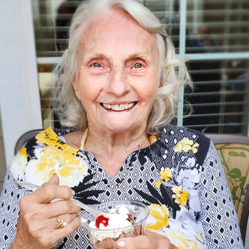 Resident eating ice cream at The Oxford Grand Assisted Living & Memory Care in Kansas City, Missouri