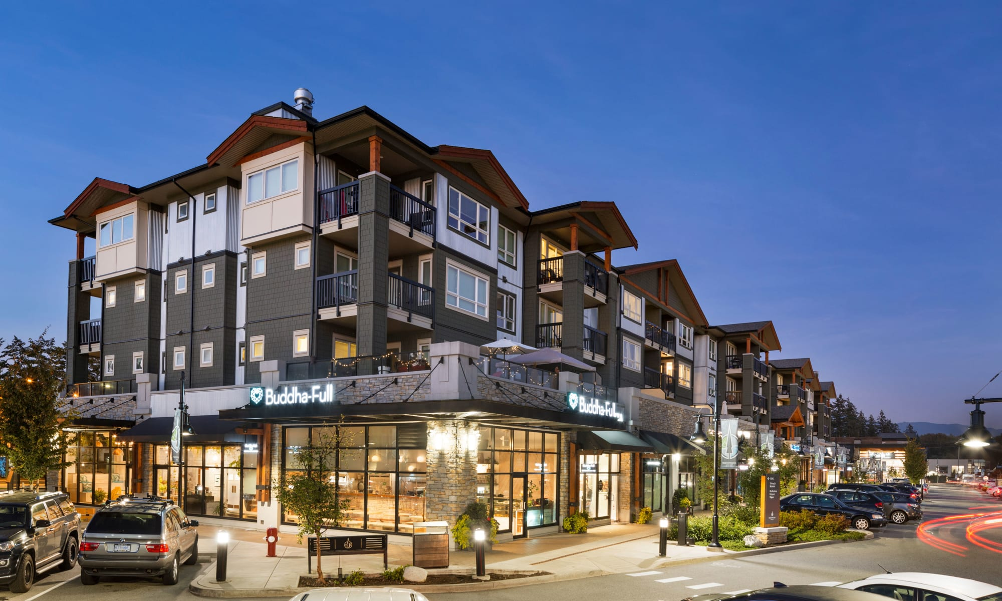Night time exterior shot of Northwoods Village in North Vancouver, British Columbia