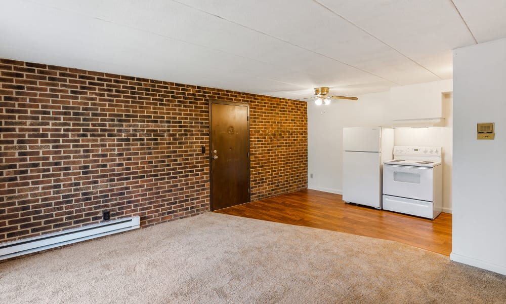 Spacious living room with brick accent wall at Brixworth Apartments in Cincinnati, Ohio