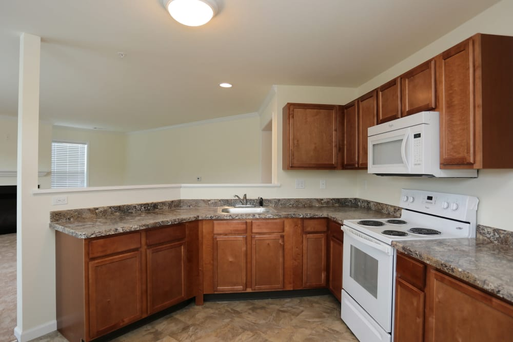 Kitchen with white appliances at The Ridge in Troy, New York