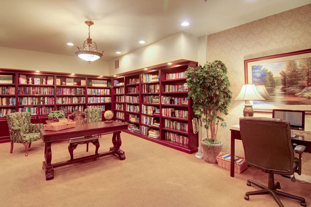 Resident library with wide selection of books at Randall Residence of McHenry in McHenry, Illinois
