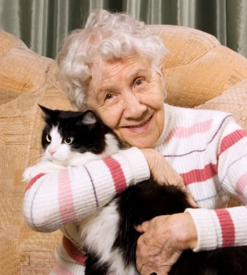 Resident hugging her cat at Absaroka Senior Living in Cody, Wyoming