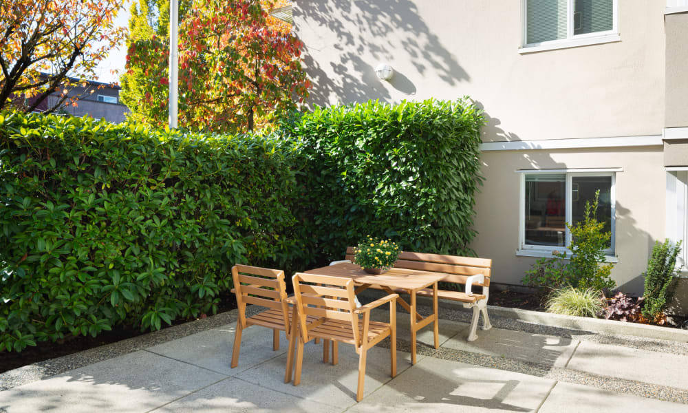 Outdoor seating in the shade at Larchway Gardens in Vancouver, British Columbia