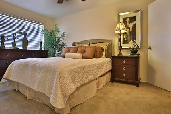 Spacious bedroom with a ceiling fan at Willow Oaks Apartments in Bryan, Texas