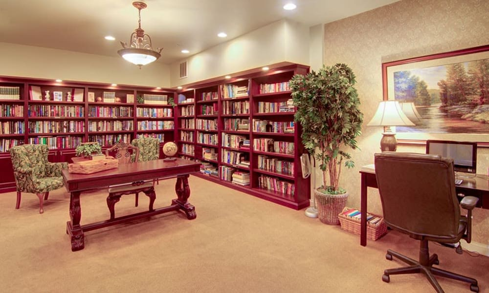 Elegant library with soft lighting and bookshelves at Randall Residence of McHenry in McHenry, Illinois