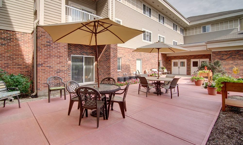 Spacious outdoor patio with seating at Randall Residence of McHenry in McHenry, Illinois
