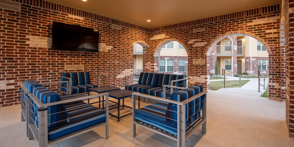 Outdoor lounge at Portico at Friars Creek Apartments in Temple, Texas