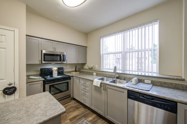 grey cabinetry kitchen at HighGrove Apartments in Everett,