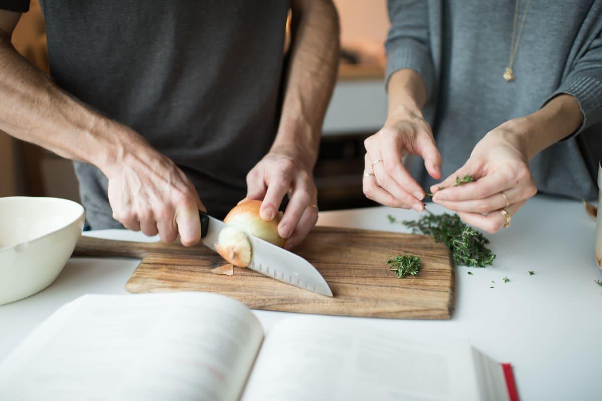 Residents cutting and preparing food at Amira Minnetonka in Minnetonka, Minnesota.
