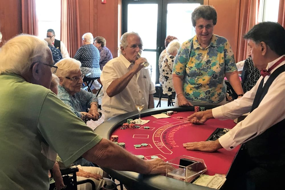 Group of residents at casino night at Merrill Gardens at Solivita Marketplace in Kissimmee, Florida.