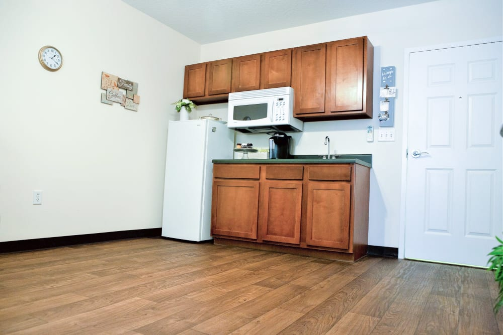Wood flooring in an apartment kitchen at The Grande in Brooksville, Florida