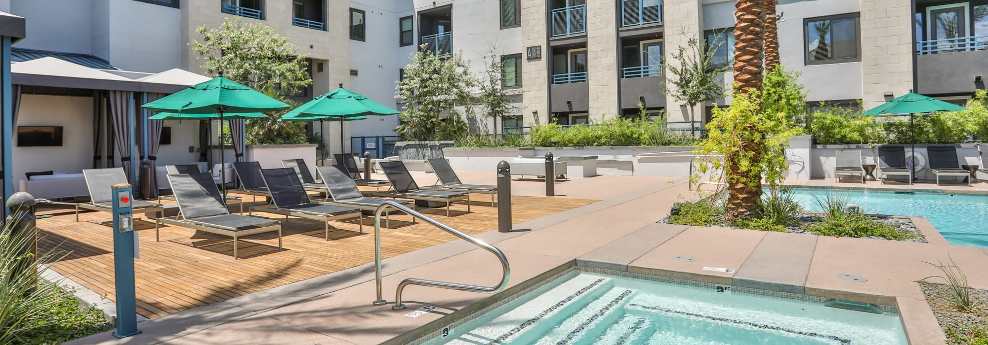 Resort-style hot tub and swimming pool at Lakeside Drive Apartments in Tempe, Arizona