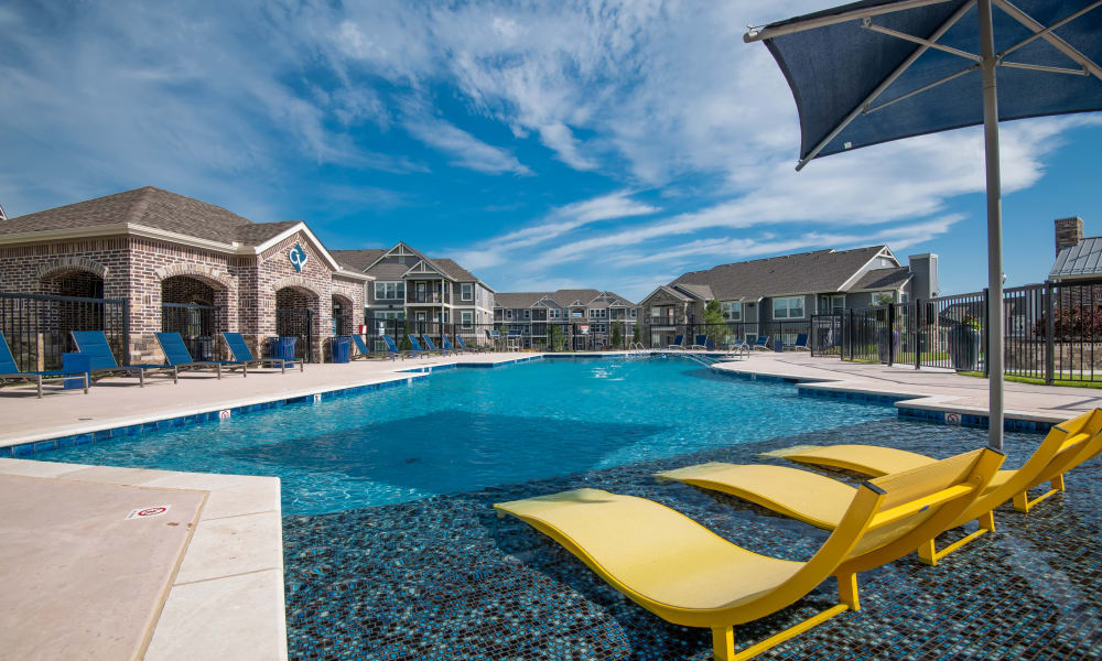 Sparkling swimming pool with poolside seating at Cottages at Crestview in Wichita, Kansas