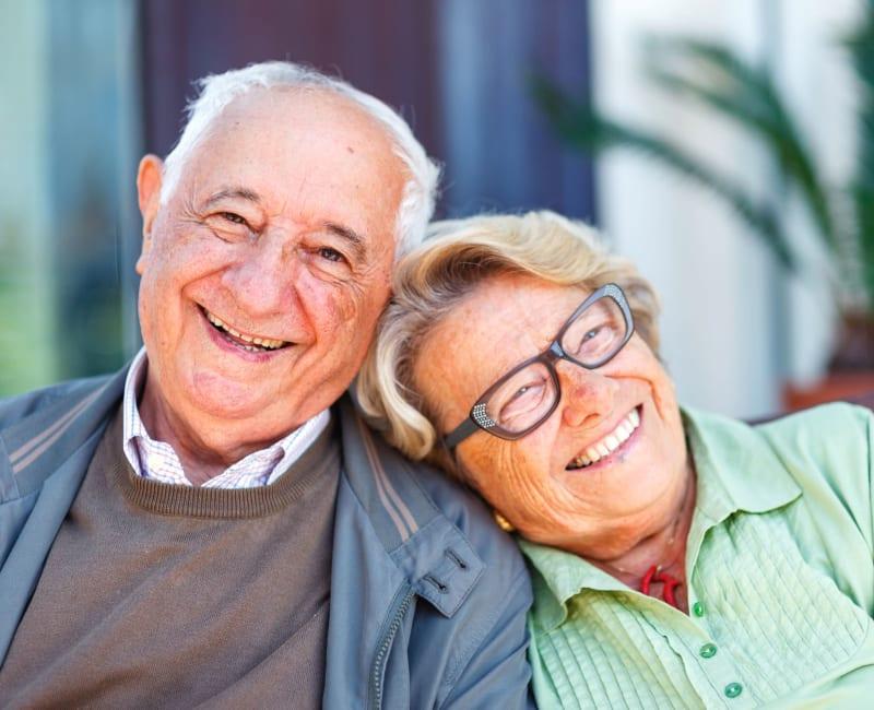 Senior Couple Sitting outside at Arbor Glen Senior Living in Lake Elmo, Minnesota