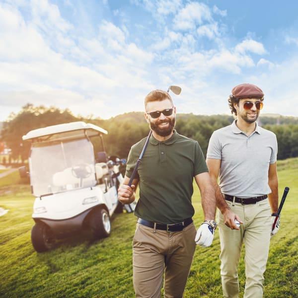 Residents out playing golf near Olympus Emerald Coast in Destin, Florida