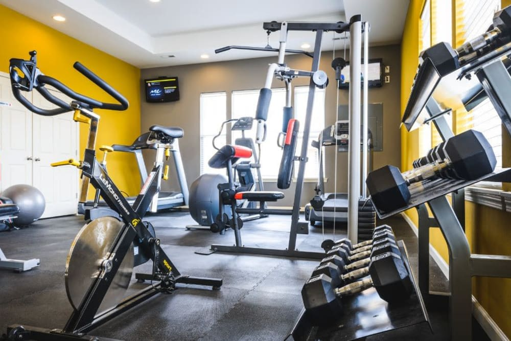Resident gym with individual workout stations at Alvadora Apartments in Lawrence, Kansas