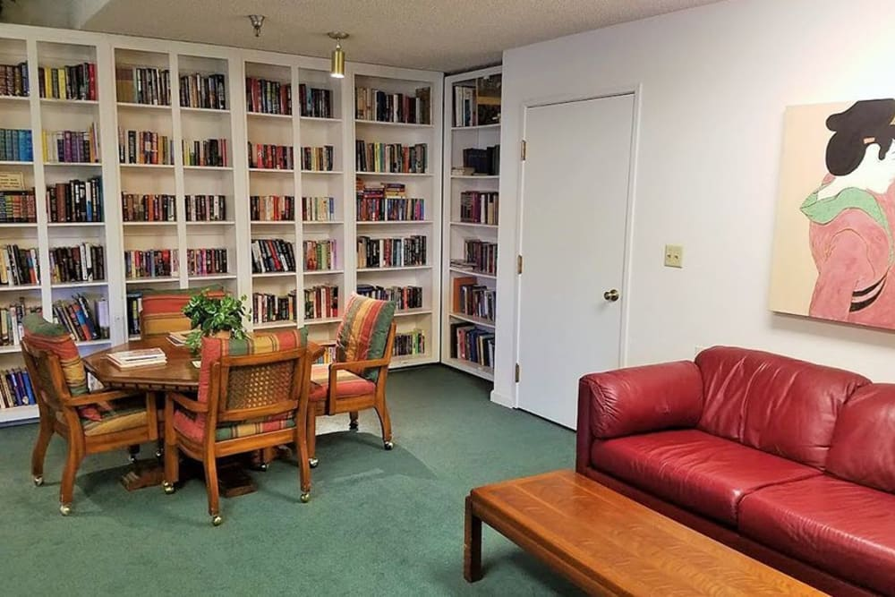 Library with lots of seating at Leisure Manor Senior Living in Sacramento, California