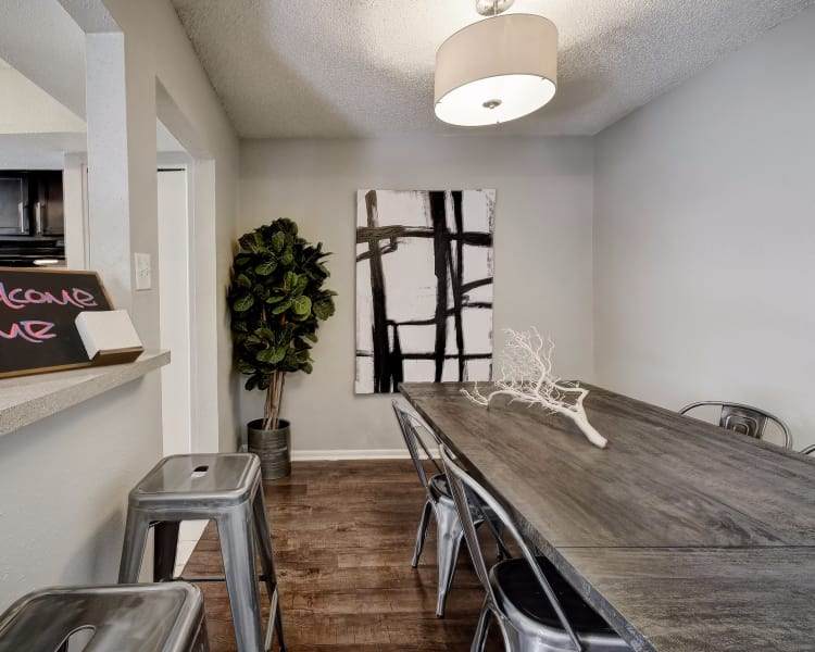 Beautiful dining table near kitchen at Oasis at Oakwell in San Antonio, Texas