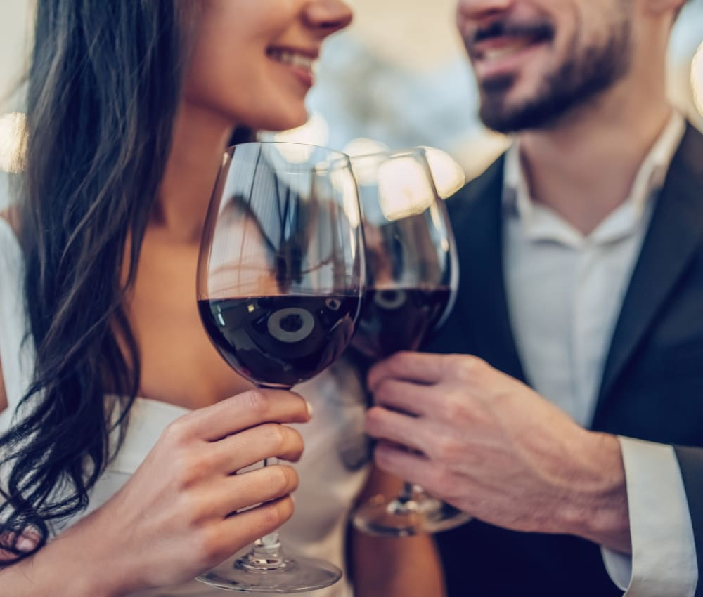 Resident couple out for a meal and some fine wine on date night near Haven Apartment Homes in Kent, Washington