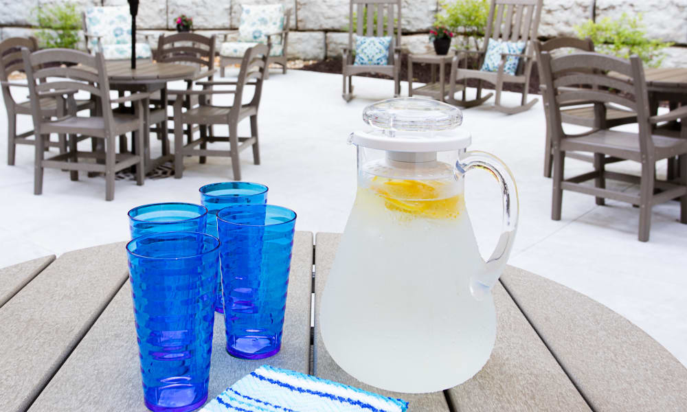 Pitcher of lemonade and 4 glasses sitting on a table outside at Serenity in East Peoria, Illinois