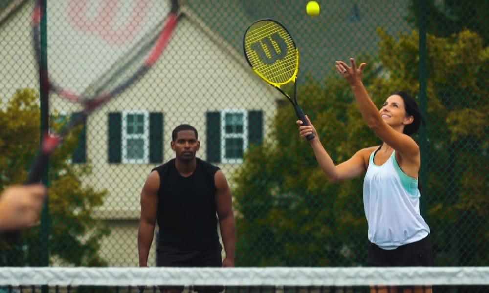 People enjoying playing tennis at Auburn Gate