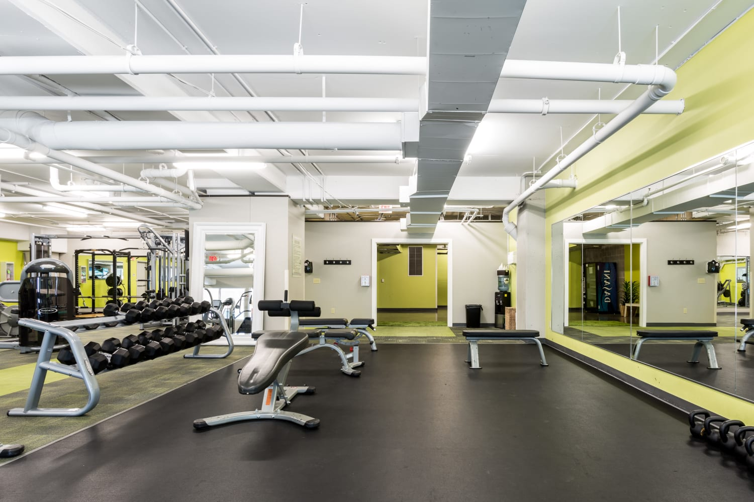 Fitness center with plenty of workout stations at The Heights at Park Lane in Dallas, Texas