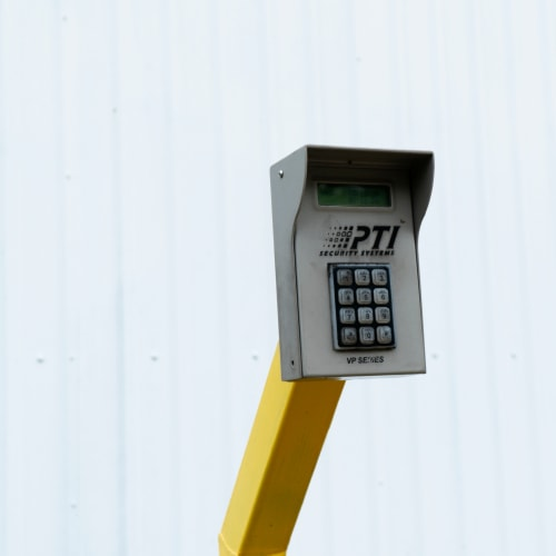 Secure entry keypad in front of a white wall at Red Dot Storage in Baker, Louisiana