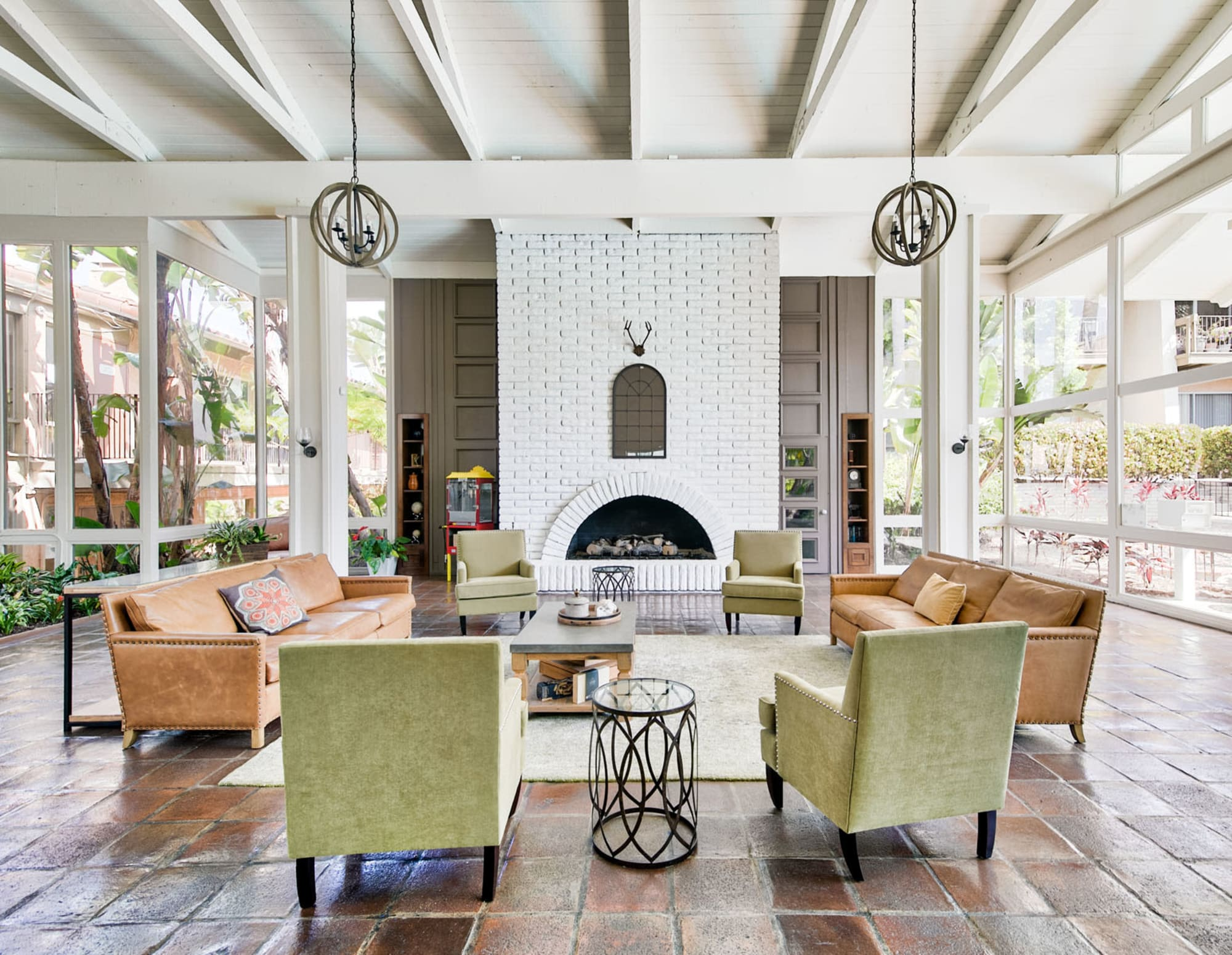 Mission-style architecture and lounge seating near the fireplace in the lobby at Mediterranean Village Apartments in Costa Mesa, California