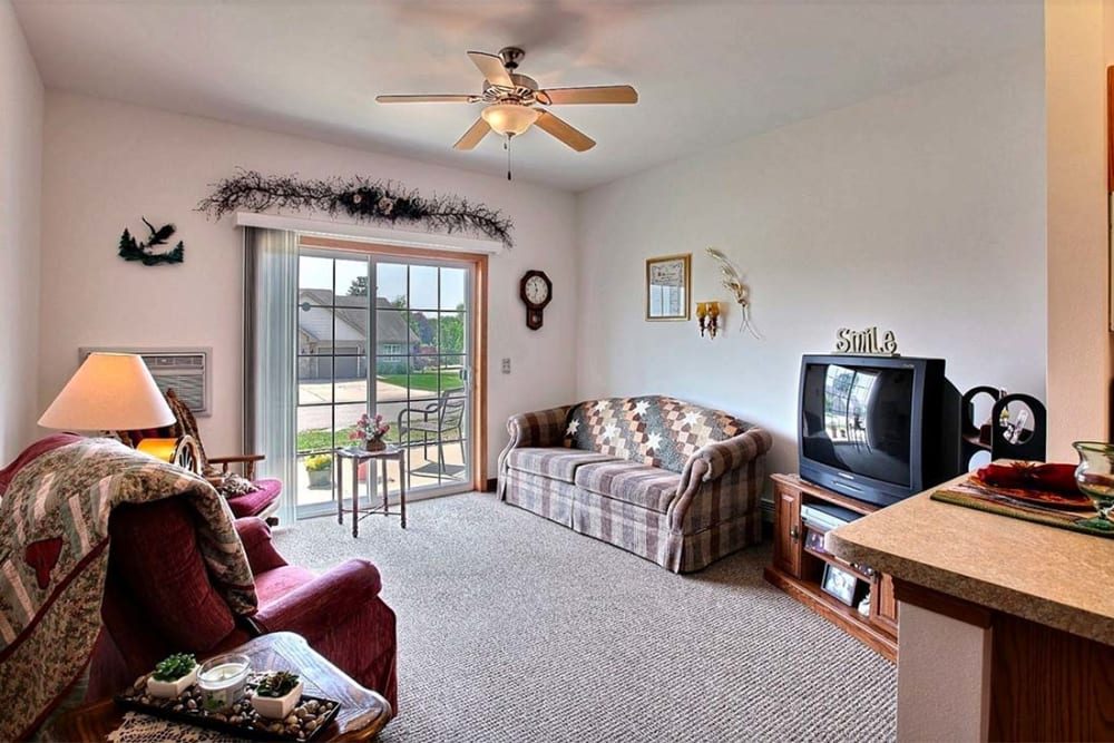 Spacious living room at Milestone Senior Living in Hillsboro, Wisconsin.
