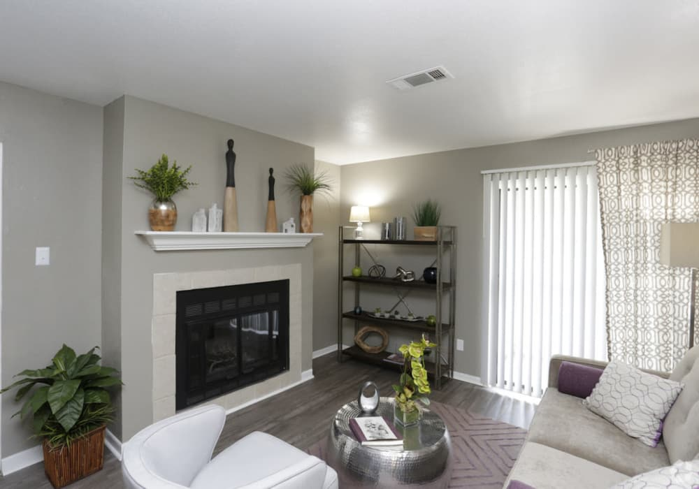Enjoy a luxury living room with fireplace at EnVue Apartments in Bryan, Texas