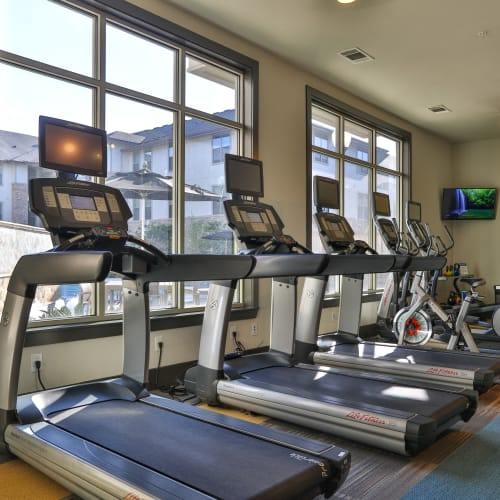 Well-equipped onsite fitness center at Olympus at Waterside Estates in Richmond, Texas