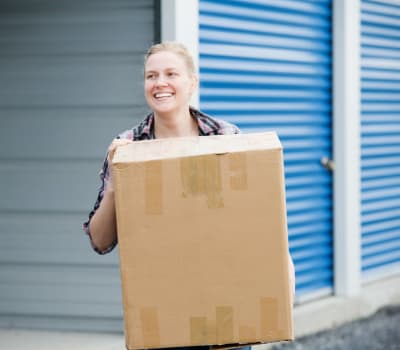 Women moving a box at Aarons Self Storage 1 in Waco, Texas