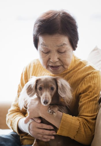 A resident holds her dog at The Claiborne at Gulfport Highlands in Gulfport, Mississippi.