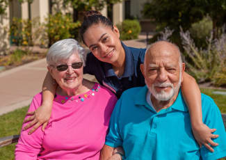 Two residents with there caretaker at Summerfield Senior Living in Bradenton, Florida