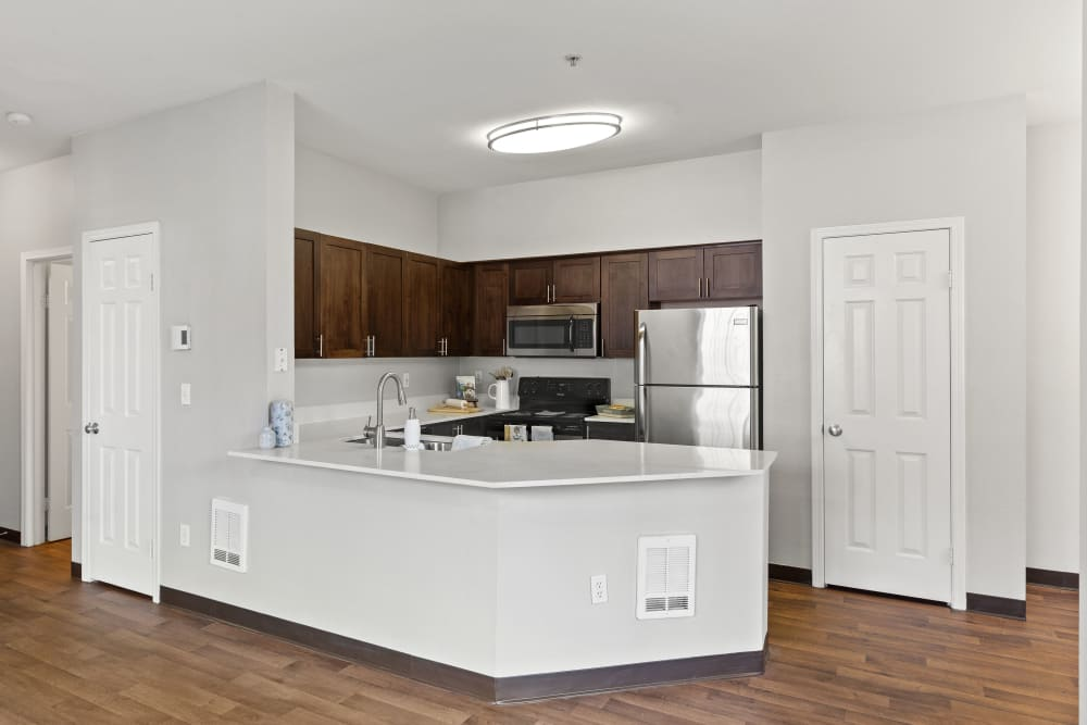 Bright dining room and kitchen at Wildreed Apartments in Everett, Washington