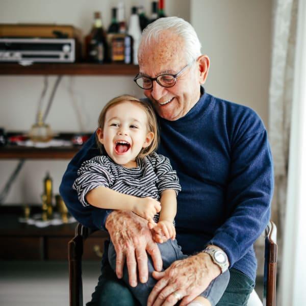 A resident holding his grandson at Pacifica Senior Living Menifee in Sun City, California.