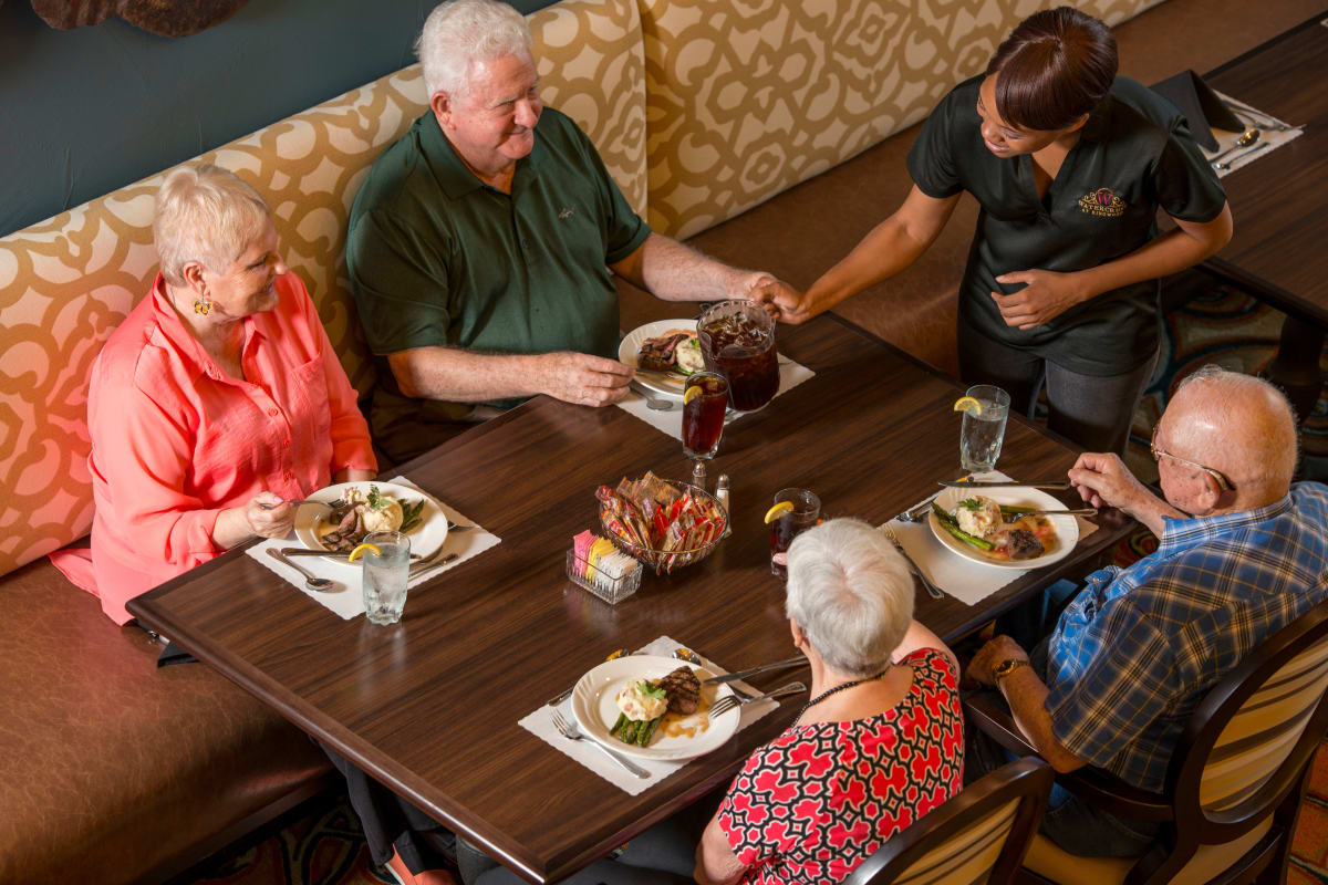 A group of people eating a meal at Watercrest at Kingwood in Kingwood, Texas