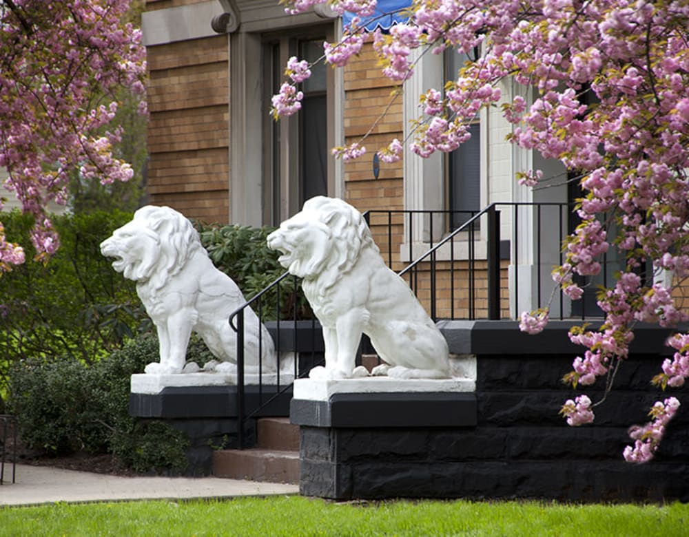 Entrance to apartment home with beautiful lion statues at Clemens Place in Hartford, Connecticut