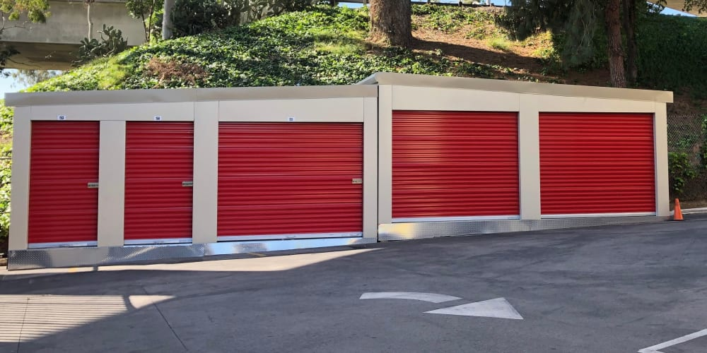 Drive-up storage units with red doors at StorQuest Self Storage in Los Angeles, California